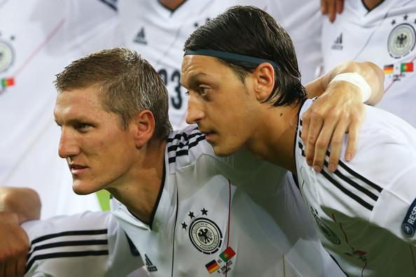 Bastian Schweinsteiger and Mesut Ozil
