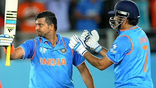 Raina (L) and Dhoni (R) were invloved in a pivotal 196-run partnership (photo: hindustantimes.com)