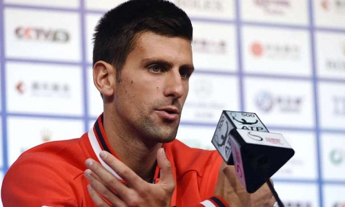 Djokovic addressing the press in Beijing, China (photo: straitstimes.com)