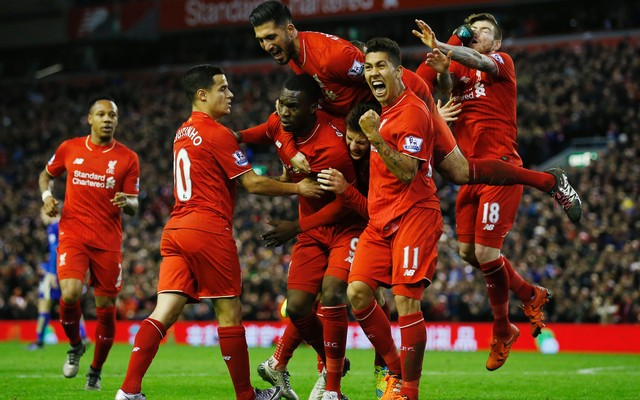 1.+Christian+Benteke+celebrates+scoring+the+first+goal+for+Liverpool+with+team+mates