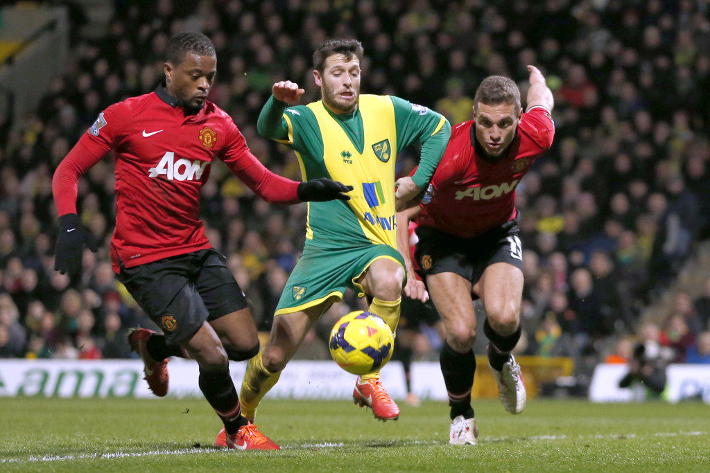 "Football - Norwich City v Manchester United - Barclays Premier League - Carrow Road - 28/12/13 Norwich City's Wes Hoolahan (C) in action with Manchester United's Nemanja Vidic (R) and Patrice Evra   Mandatory Credit: Action Images / John Sibley Livepic EDITORIAL USE ONLY. No use with unauthorized audio, video, data, fixture lists, club/league logos or ""live"" services. Online in-match use limited to 45 images, no video emulation. No use in betting, games or single club/league/player publications.  Please contact your account representative for further details."