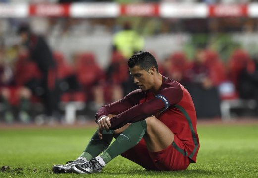 Portugal's forward Cristiano Ronaldo reacts after failing to score a penalty kick during the EURO 2016 friendly football match Portugal vs Bulgaria at Magalhaes Pessoa stadium in Leiria on March 25, 2016.