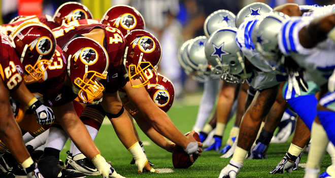 The Washington Redskins offense gets set at the line of scrimmage against the Dallas Cowboys defense during an NFL Football game on Monday, September 26, 2011 in Dallas. The Cowboys won 18-16. (AP Photo/G. Newman Lowrance)